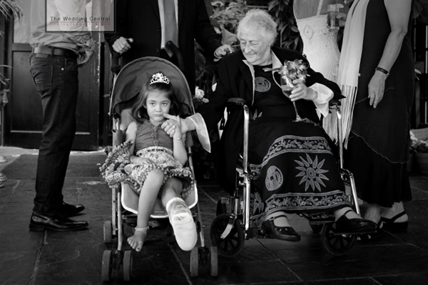 Photojournalistic Brooklyn Wedding Pictures at River Cafe - grandma and grand daughter wheel chair