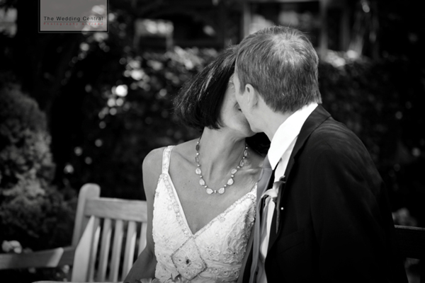 Photojournalistic Brooklyn Wedding Pictures BW bride and groom kissing