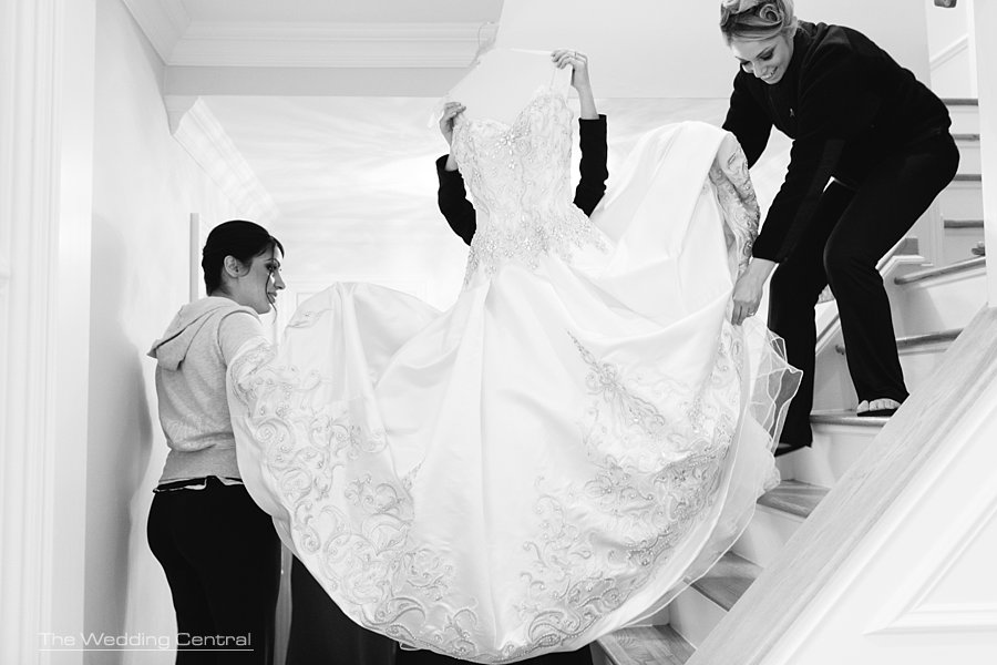 bridesmaids carrying wedding dress - the grove wedding photos - Diana and John wedding