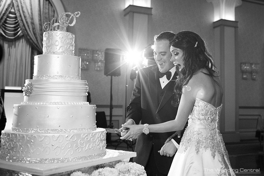 Bride and groom cutting cake - the grove wedding photos