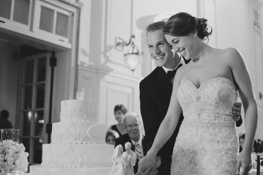 Bourne Mansion Wedding Photos - candid wedding photo of bride and groom cutting cake - New York Wedding Photographers