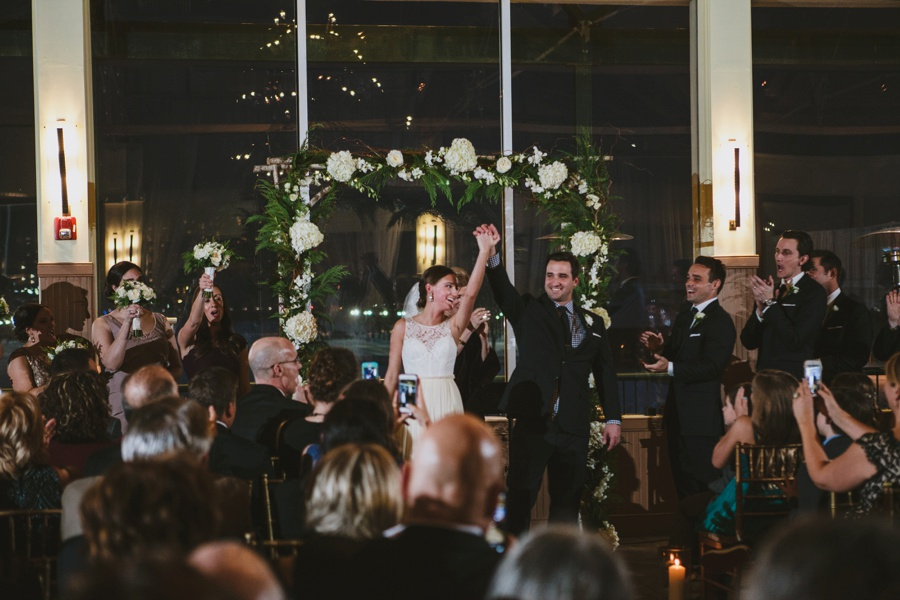 Bride and Groom walking down the aisle happy after Wedding Ceremony at Liberty House Wedding Photography