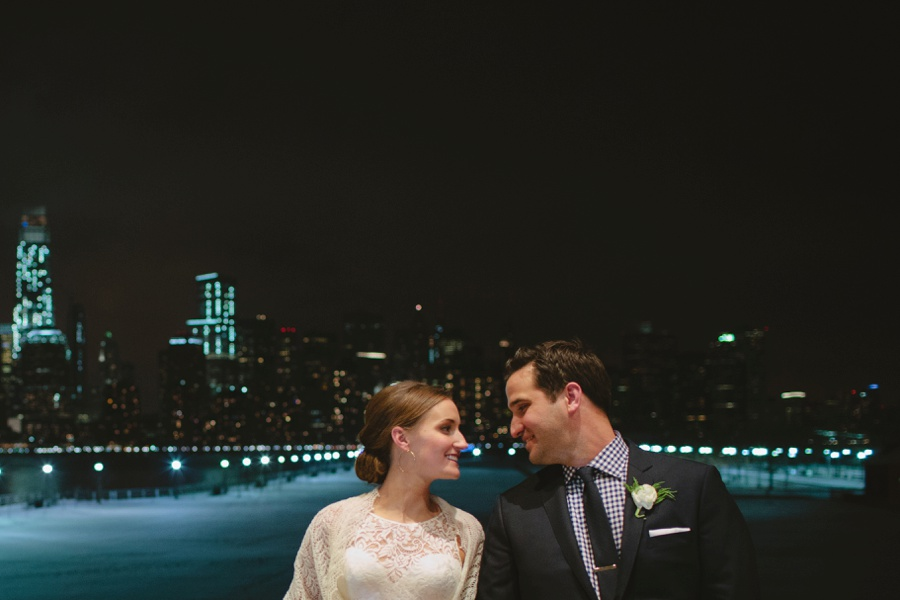 Photo of Bride and Groom at night with NYC background during their wedding - Liberty House Wedding Photography