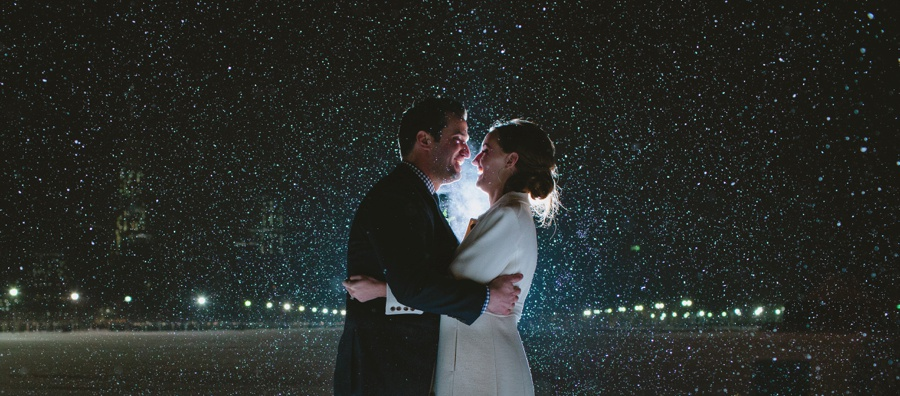 Liberty House Wedding Photography - Photo of Bride and Groom at night during the snow with NYC background during their wedding