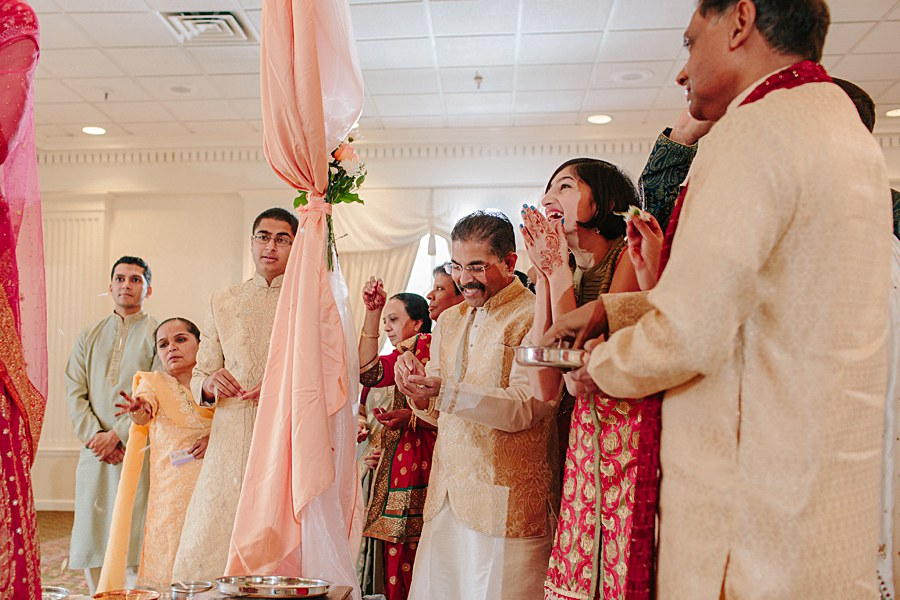 Family laughing during Indian Wedding Ceremony
