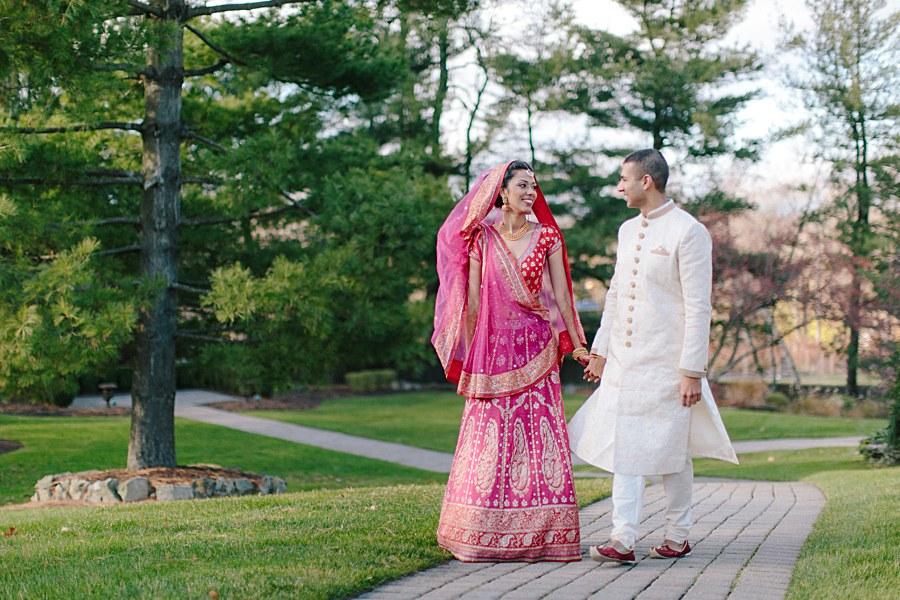 Happy Bride and Groom Wedding Portrait Walking after wedding ceremony