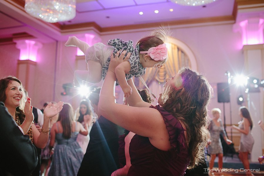 guest carrying a baby - the grove wedding photos - Diana and John wedding