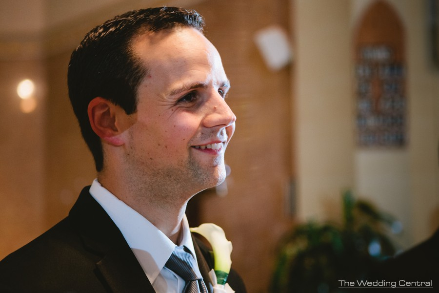 candid wedding photos - groom waiting for bride at the altar