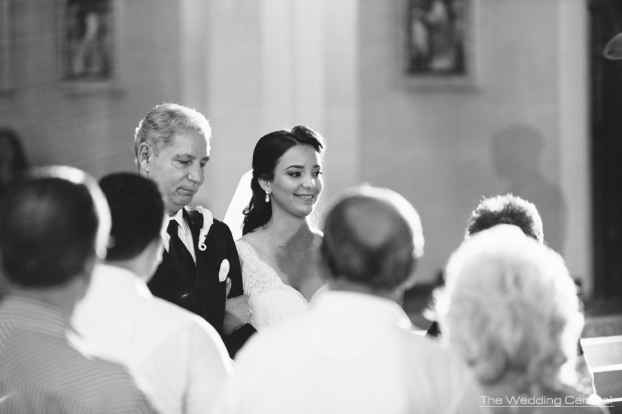 candid wedding photography - bride walking down the aisle
