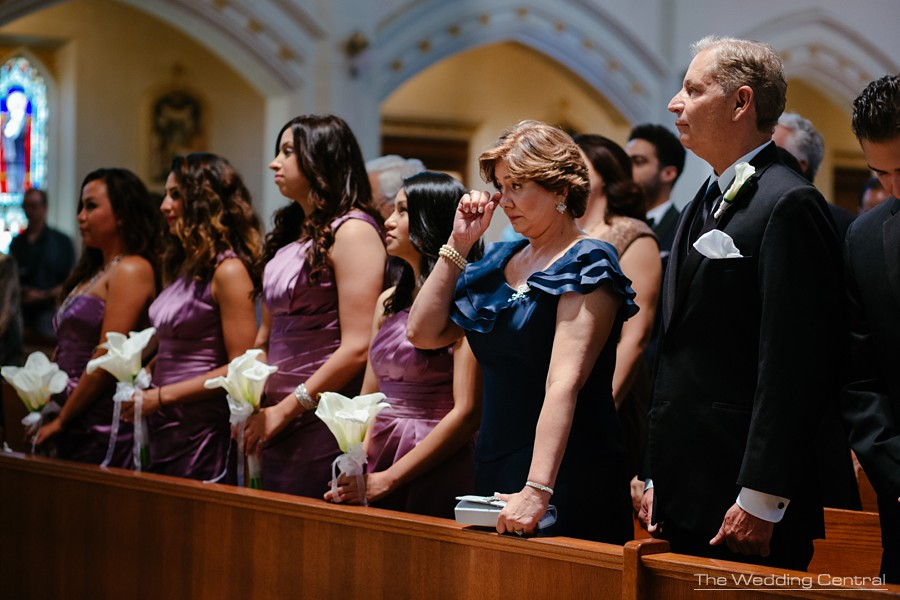candid wedding photography - ceremony mother of the bride crying