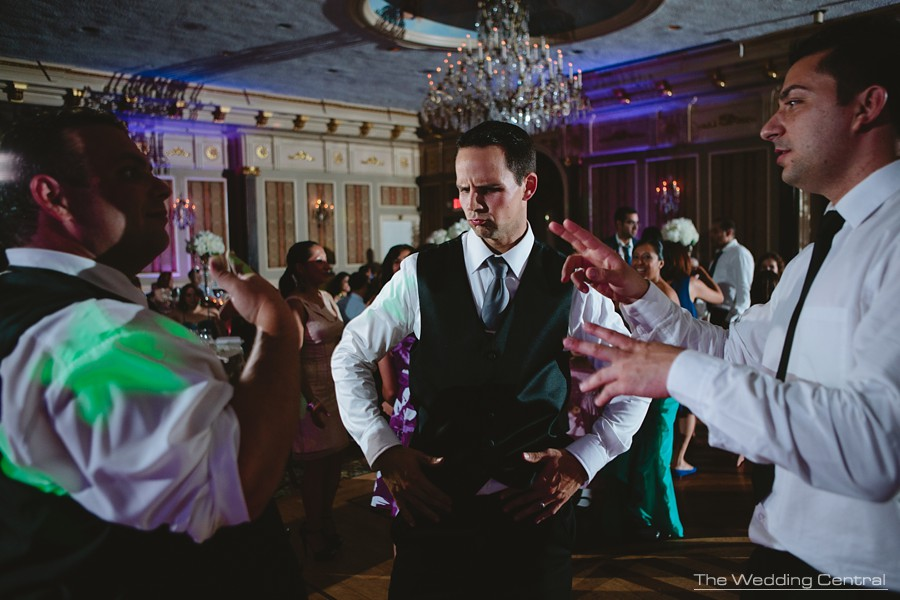 candid wedding photography in new jersey - groom and groomsmen dancing and having fun during reception