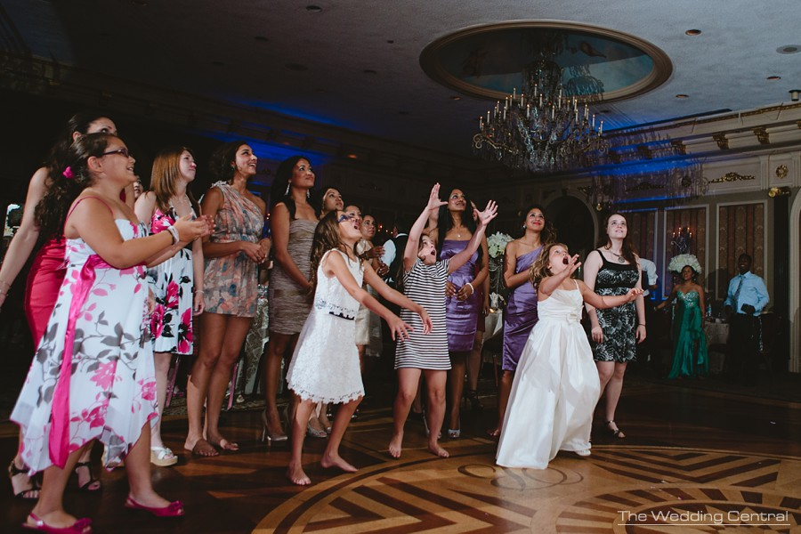 candid wedding photography in new jersey - bouquet toss dancing and having fun during reception