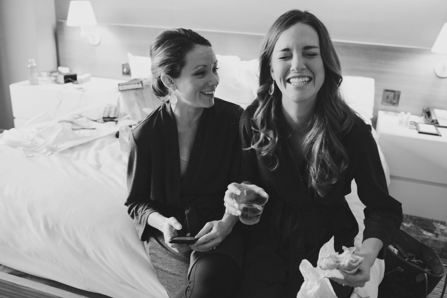 Bridesmaids laughing getting ready - Candid photojournalistic wedding photography in New Jersey