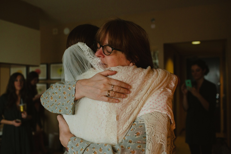 Emotional embrace of bride and aunt - Candid wedding photography
