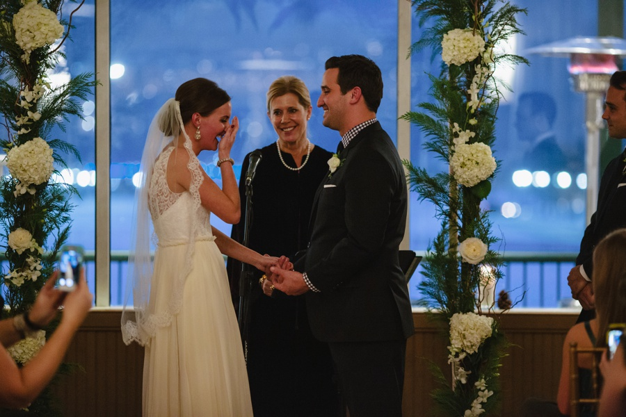 Bride laughing exchanging vows during Wedding Ceremony - Liberty House Wedding Photography
