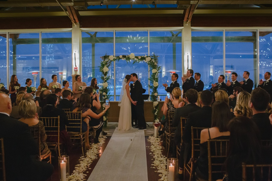 Kissing at Wedding Ceremony - Liberty House Wedding Photography