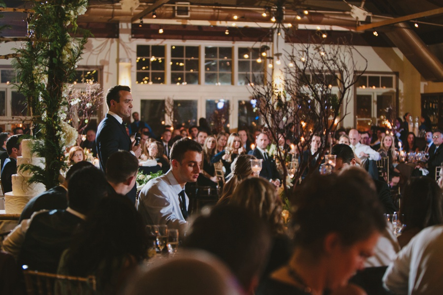 Bride and groom laughing during toast - Liberty House wedding Photography