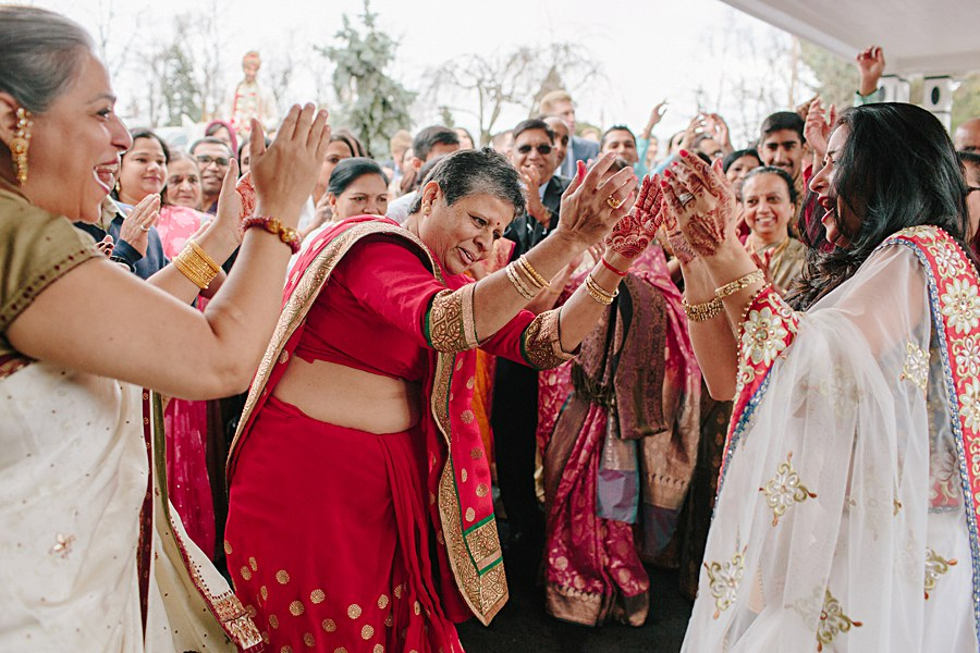 Bride and Groom's Family dancing during Baraat