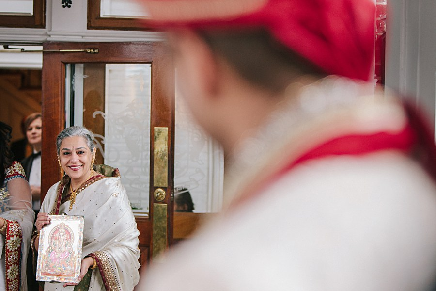Mother of the bride welcoming groom during Indian Wedding's Baraat