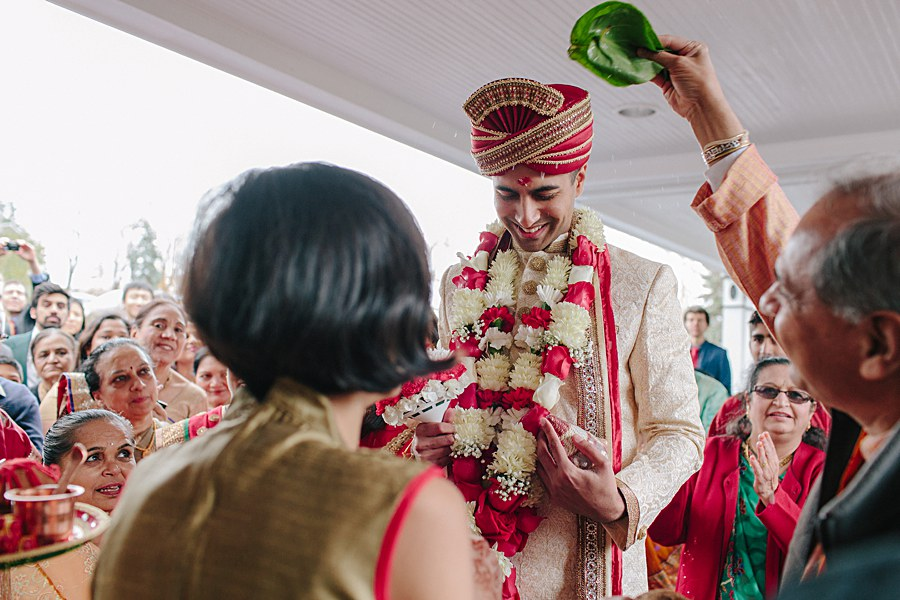 Indian Wedding Groom being welcomed during baraat