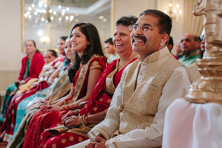 Family happy and laughing during Indian Wedding