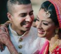 Happy Bride and Groom Wedding Portrait with traditional Indian Outfits