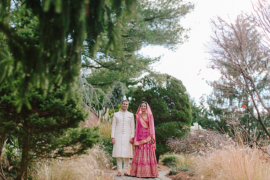 Traditional Bride and Groom Portrait wearing traditional Indian Outfits