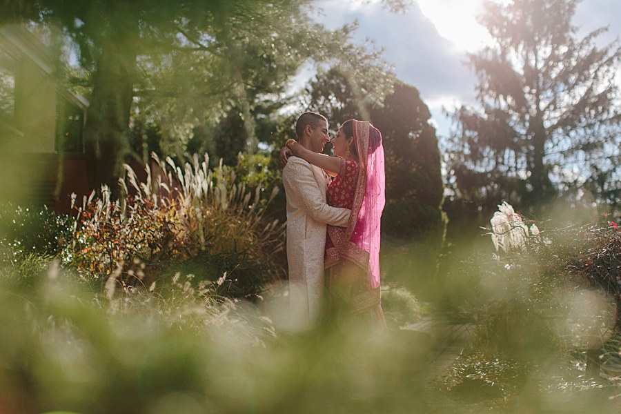 Outdoors Bride and Groom Wedding Portrait with traditional Indian Outfits